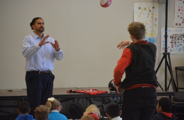 Dj Tialavea of the Atlanta Falcons speaking at West Jordan School 1