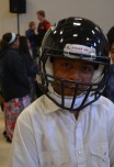 student wearing helmet after meeting Dj Tialavea of the Atlanta Falcons speaking at West Jordan School